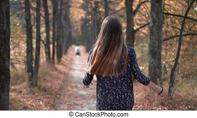 Beautiful Young Woman Running Through Forest Sun Shining
