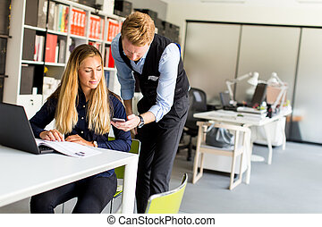 Young couple in office