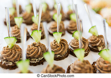 close up of canape with paste on serving tray - food,...