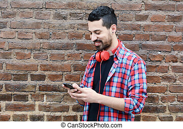 Young man using a smartphone.