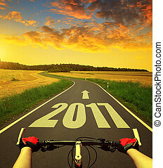 Forward to the New Year 2017 - Cyclist riding a bike at...