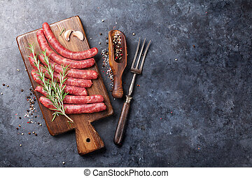 Raw sausages and ingredients for cooking. Top view with copy...