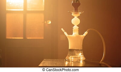 glass hookah on a table in the room - Beautiful glass hookah...