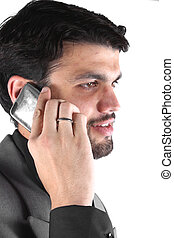 Businessman on Phone - A portrait of a young Indian...