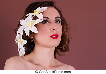 Beautiful woman with flower hairstyle