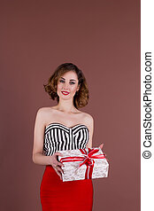 young pretty woman with a gift