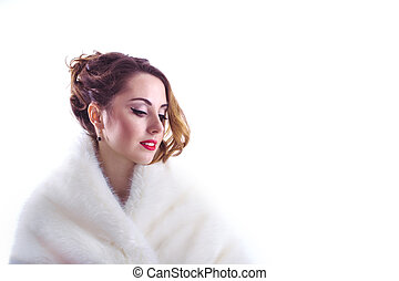 Woman in fur coat isolated on a white background
