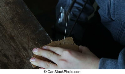 Little handsaw sawing wood veneer - Teenager using a handsaw...