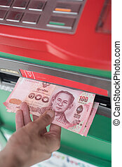 Woman withdraw cash from ATM - Closeup of woman's hand...