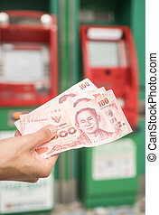 Woman holding cash withdrawned from ATM - Closeup of woman's...