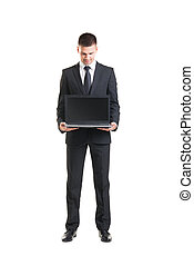Young businessman wih a laptop isolated on white