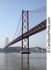 The 25 de Abril Bridge - suspension bridge over the river...