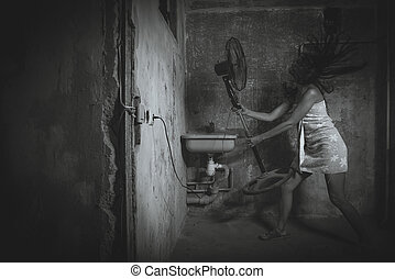 Cheap accommodation. Girl dries hair improvised means. Black...