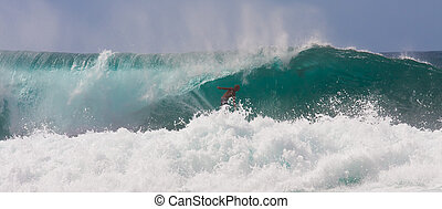 Fearless Surfer Riding a Huge Wave - A fearless surfer is...