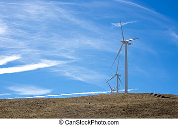 Three wind turbines on top of a hill