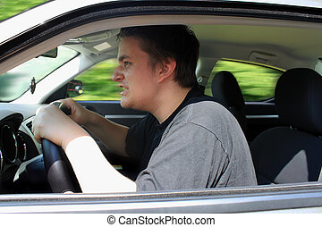 road rage - Angry young male driver speeding very fast...