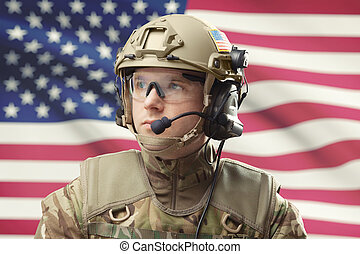 Young military man wearing helmet with USA flag on...
