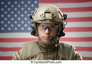 Young military man wearing helmet with USA flag on background