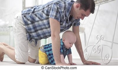 Baby learning to crawl - The child learns to crawl with his...