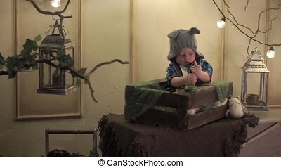 Child in a cap plays a pyramid - The child in a hat with...