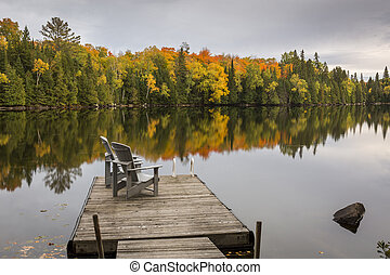 Empty Chairs on a Dock in Autumn - Ontario, Canada - A pair...