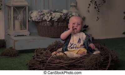 Child sitting in the nest