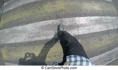 legs are at a pedestrian crossing slow motion