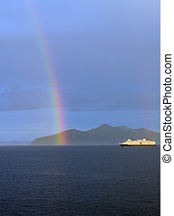 Cruise ship with a rainbow in the Gastineau Channel near...