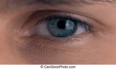 Beautiful blue man eyes with conatc lense close up -...
