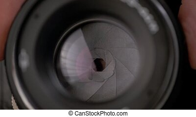 The diaphragm of old camera lens aperture with warm light...