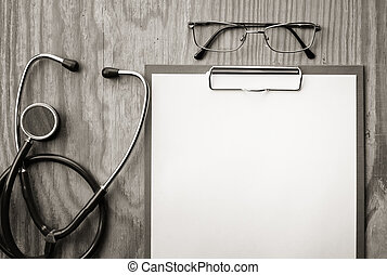 stethoscope on wooden paper glasses - background papers and...