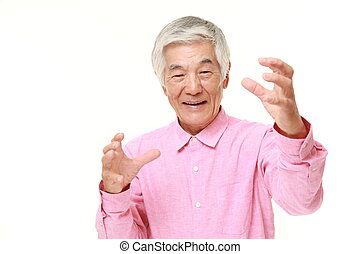 senior Japanese man with supernatural power - studio shot of...