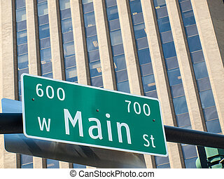 Main Street Sign in Front of Office Building