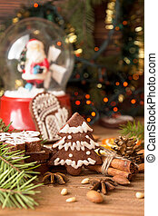 Christmas gingerbread cookies against background sphere with...