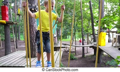 kids playing in adventures park - children playing in...