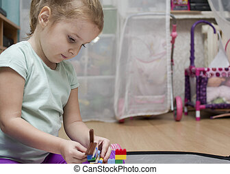 Girl Busy With Toys