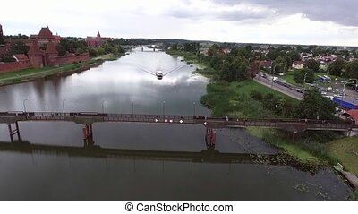 aerial view of travel ship in river with green banks -...