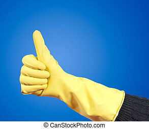 rubber glove - hand in rubber gloves lifts thumb upwards