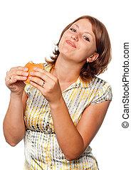 Girl eats a hamburger