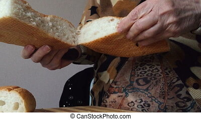 Grandma sliced bread in the kitchen