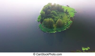 small island in lake - aerial view of small island in lake