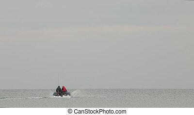Fishermen float on the boat - Fishermen float on an...