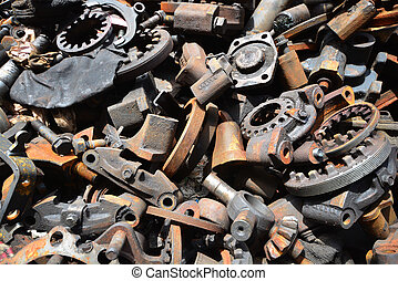 Pile of old motor parts scrap metal for recycling