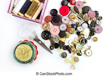 sewing stuff buttons nails thread scissors mixed still life...