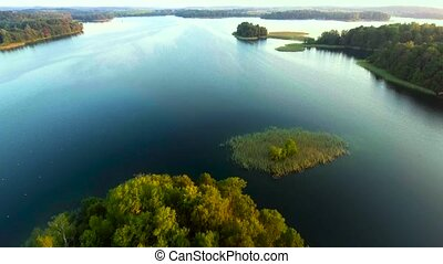 green island in blue lake - aerial view of green island in...