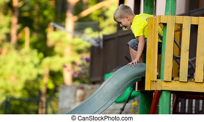 children playing on slide in park