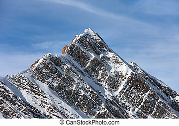 Snowy mountain peak sunny landscape in Alps