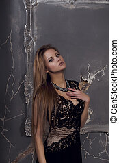Sensual woman with blonde hair dressed in lace dress