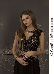 Pretty woman with blonde hair dressed in lace dress