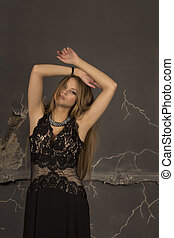 Attractive woman with blonde hair dressed in lace dress